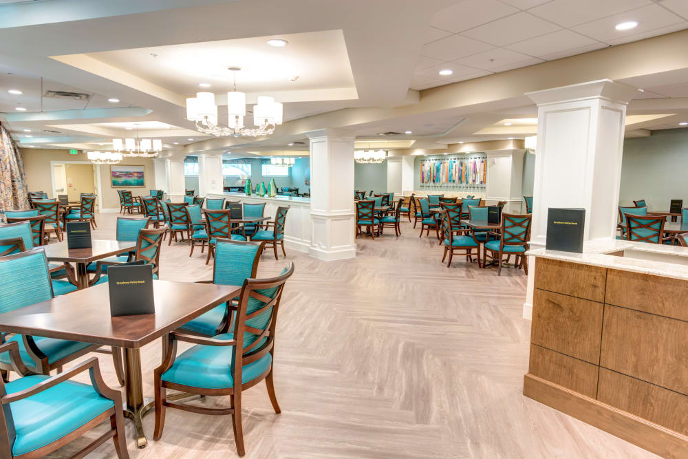 Spacious resident dining area at Symphony at Delray Beach in Delray Beach, Florida.