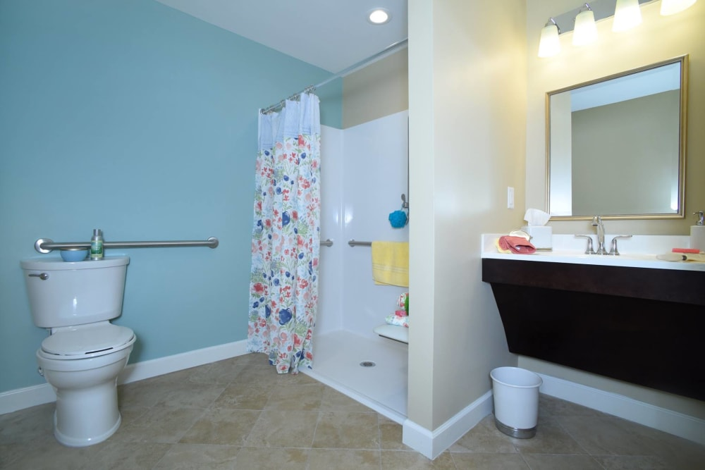 Spacious resident bathroom at Symphony at Cherry Hill in Cherry Hill, New Jersey.