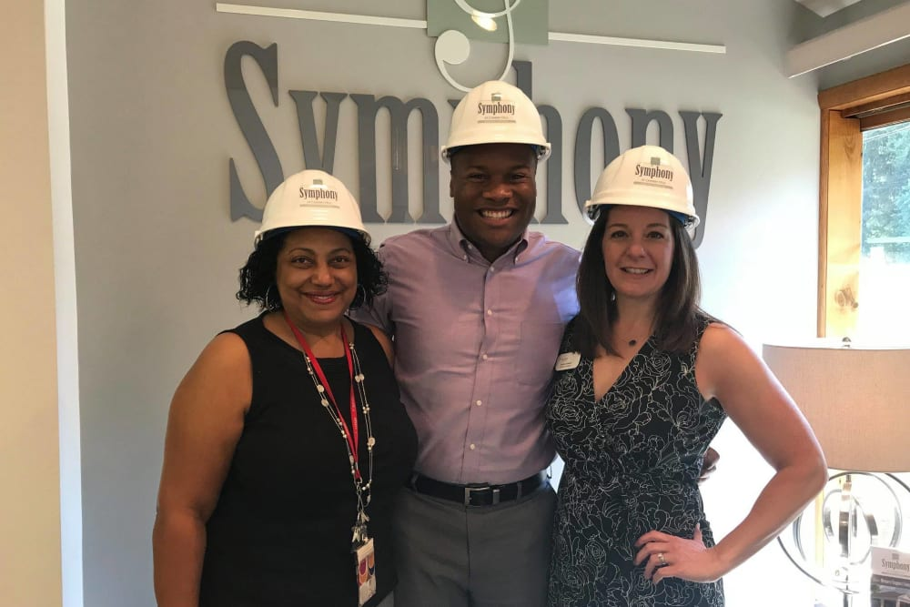 Staff wearing construction hats at Symphony at Cherry Hill in Cherry Hill, New Jersey.