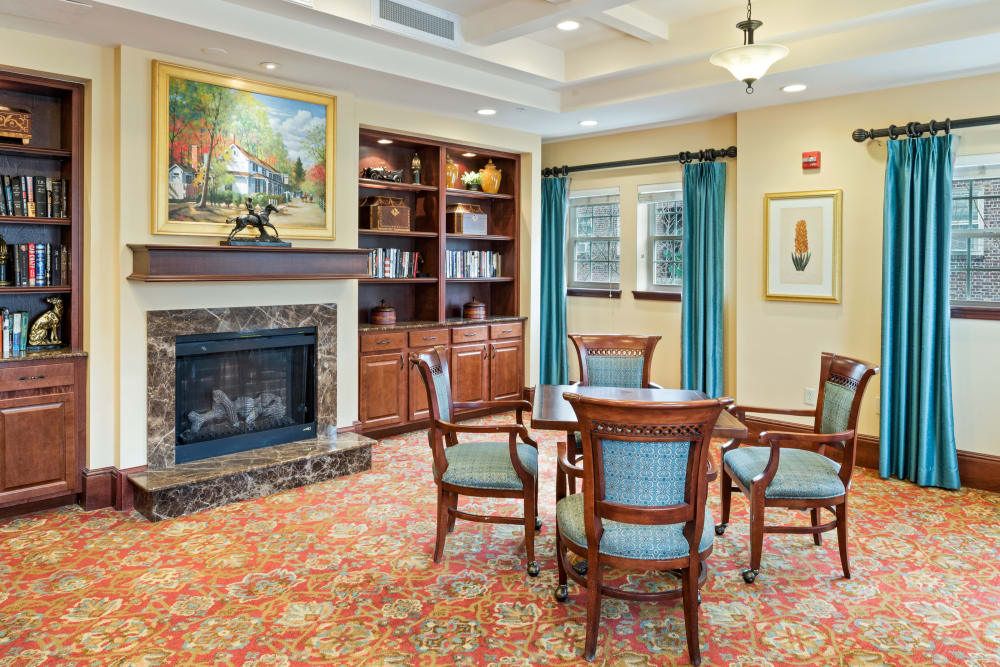 game room with a fireplace at Symphony Square in Bala Cynwyd, Pennsylvania