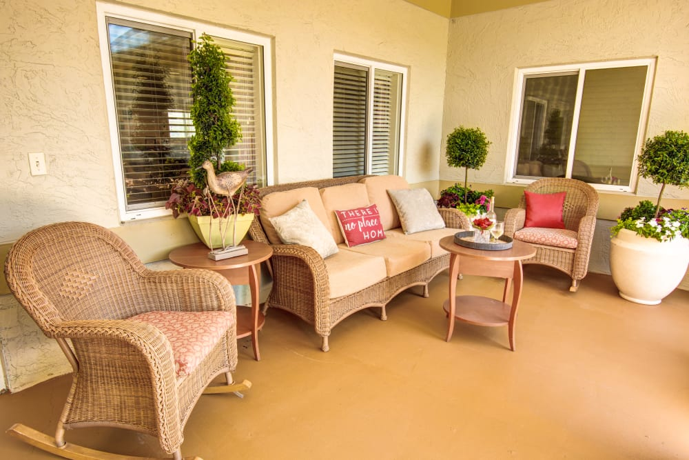 Porch sitting area at The Lynmoore at Lawnwood Assisted Living and Memory Care in Fort Pierce, Florida.