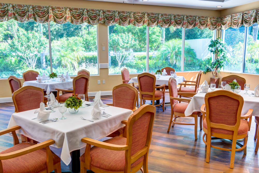 Dining room with a view at The Lynmoore at Lawnwood Assisted Living and Memory Care in Fort Pierce, Florida.