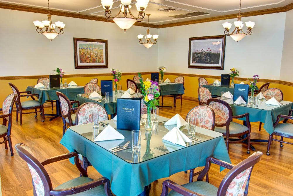Dining hall with hardwood floors at The Wentworth at East Millcreek in Salt Lake City, Utah