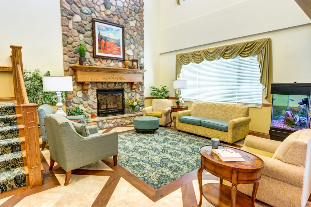 Lounge seating in front of a fireplace at The Wentworth at East Millcreek in Salt Lake City, Utah
