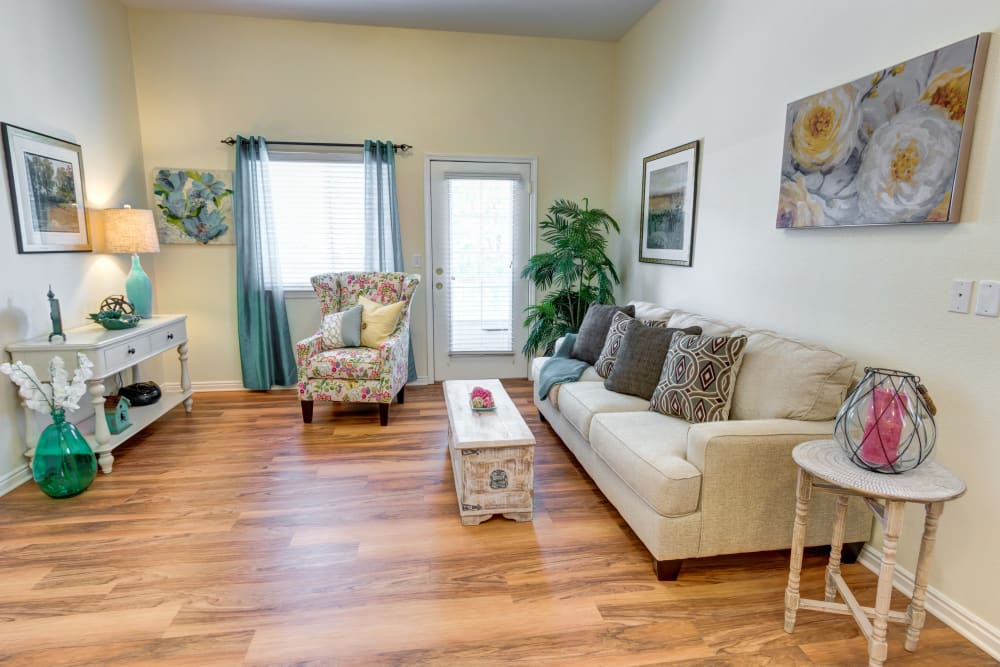 Furnished living room in model unit at The Wentworth at Coventry in Salt Lake City, Utah