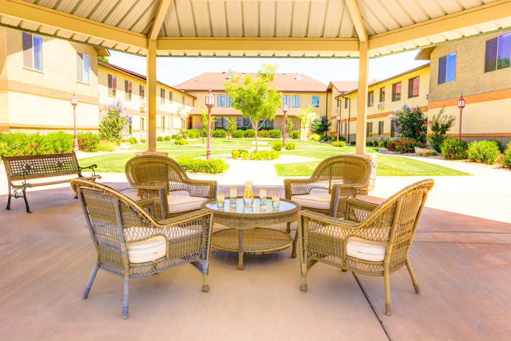Outdoor covered seating at The Wentworth at the Meadows in Saint George, Utah