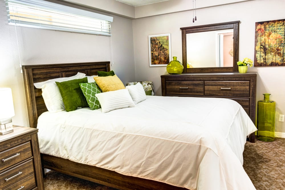 Model unit with bed and dresser at The Wentworth at the Meadows in Saint George, Utah