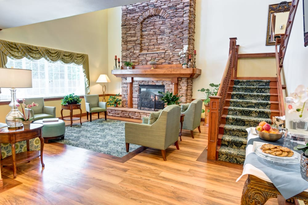 Fireplace lounge next to the stairs at The Wentworth at Willow Creek in Sandy, Utah