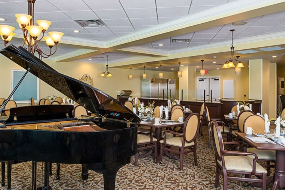Dining hall with piano at Grand Villa of St. Petersburg in Florida