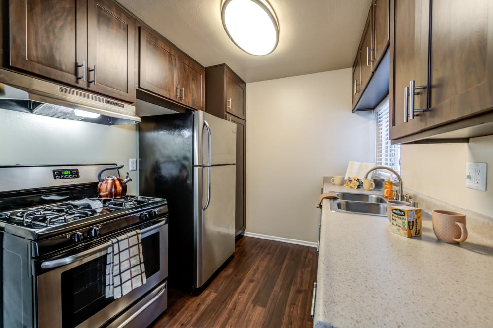 Brown kitchen with stainless steel appliances