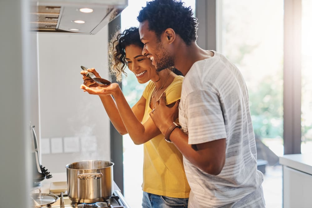 Couple cooking together at Deer Valley in Guilderland, New York