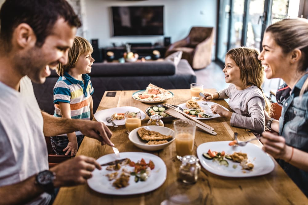 Family eating dinner together at Deer Valley in Guilderland, New York