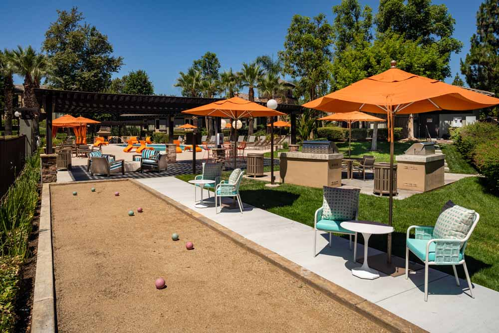 Outdoor bocce by the pool at Colonnade at Sycamore Highlands in Riverside, California