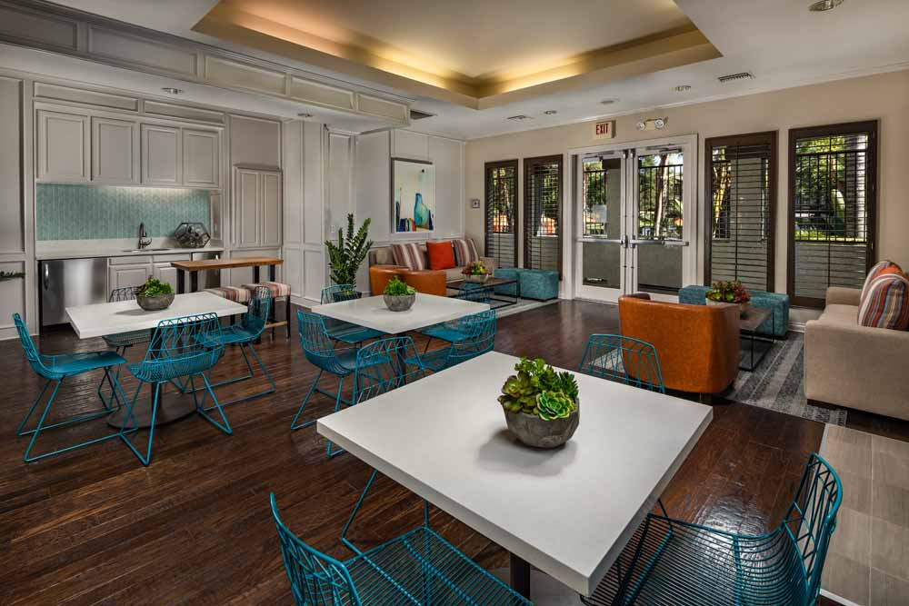 Fireside seating in the clubhouse at Colonnade at Sycamore Highlands in Riverside, California