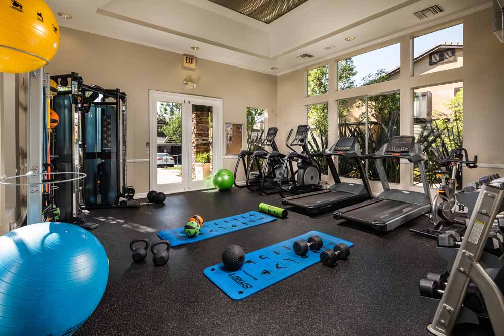 Exercise equipment in the gym at Colonnade at Sycamore Highlands in Riverside, California
