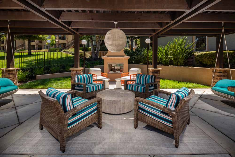 Covered outdoor fireside seating at Colonnade at Sycamore Highlands in Riverside, California