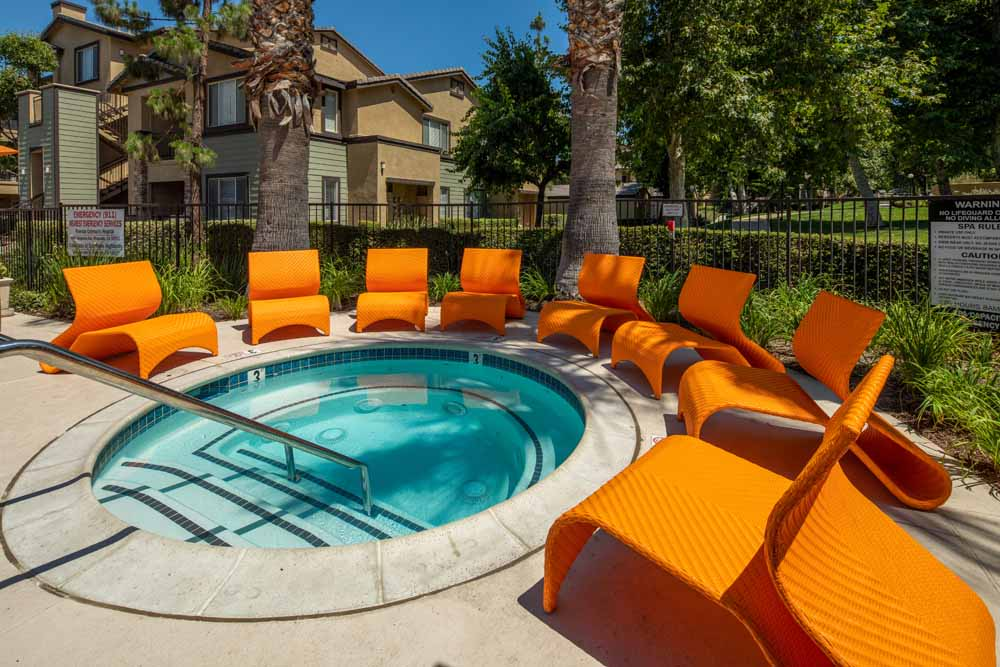 Seating around the hot tub at Colonnade at Sycamore Highlands in Riverside, California