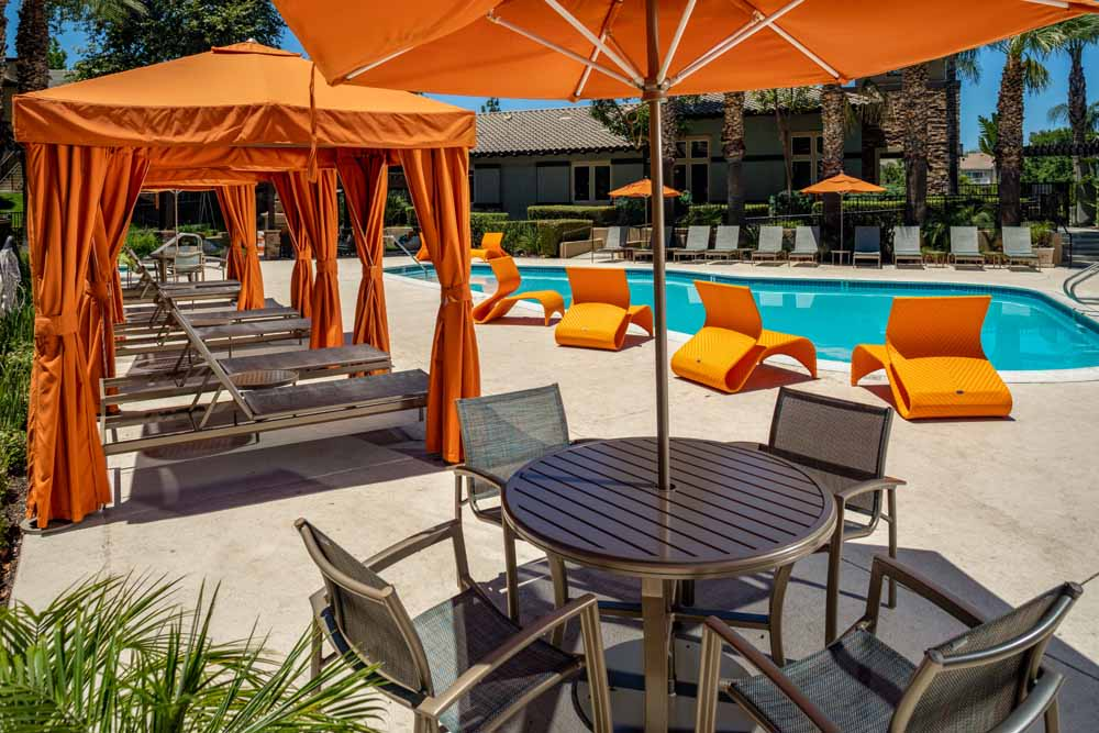 Covered outdoor poolside seating at Colonnade at Sycamore Highlands in Riverside, California