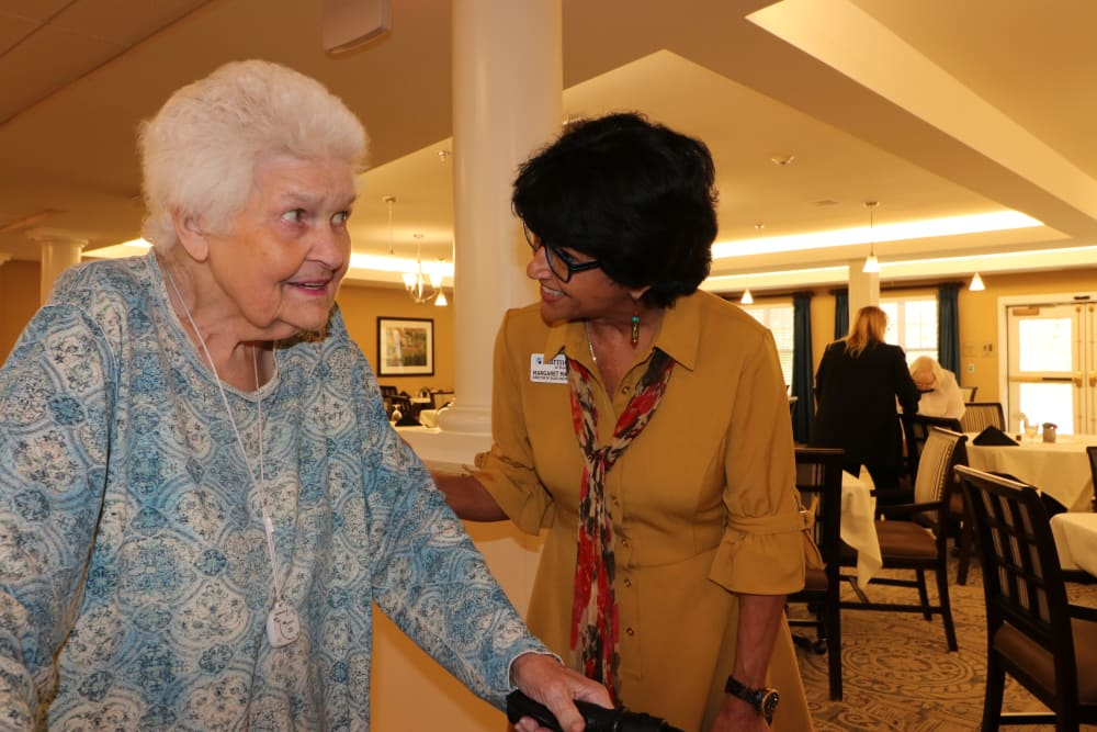 A resident and staff member at The Harmony Collection at Roanoke - Assisted Living in Roanoke, Virginia