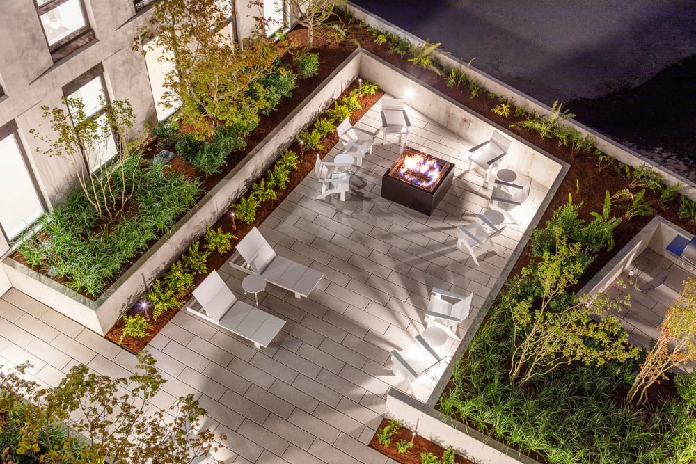 View of the outside fire pit and surrounding landscaping from an upper floor at TwentyTwenty Apartments in Portland, Oregon