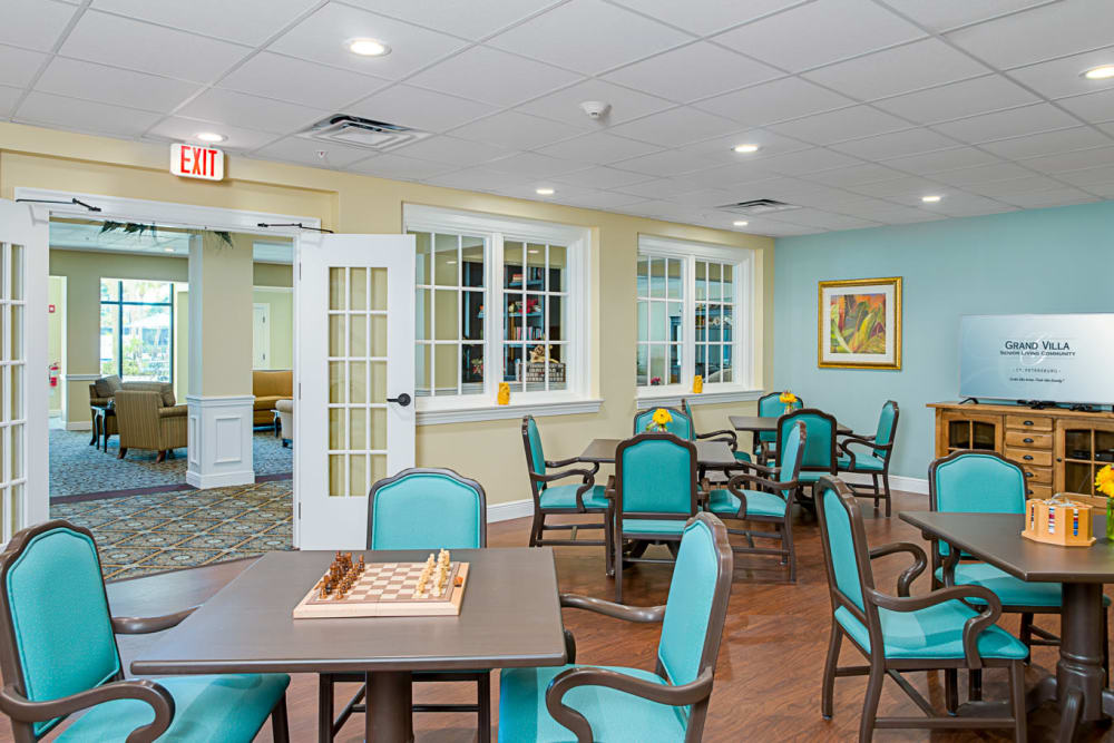 Game room with blue chairs at Grand Villa of St. Petersburg in Florida