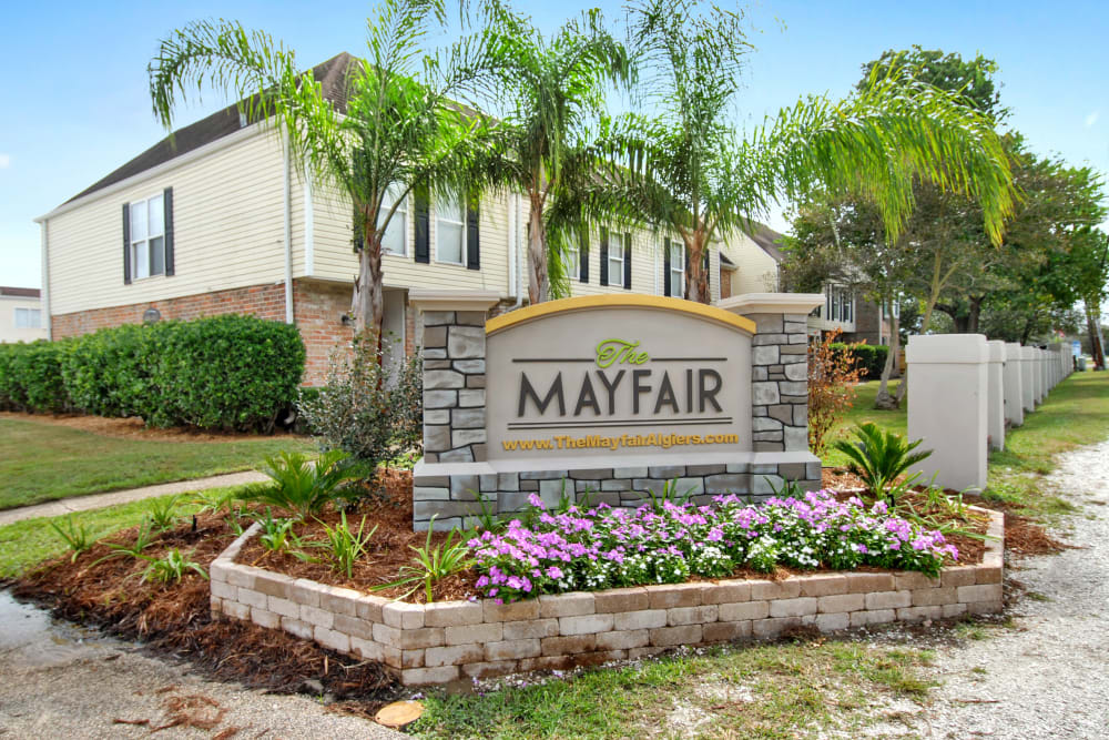 Property welcome sign at The Mayfair Apartment Homes in New Orleans, Louisiana