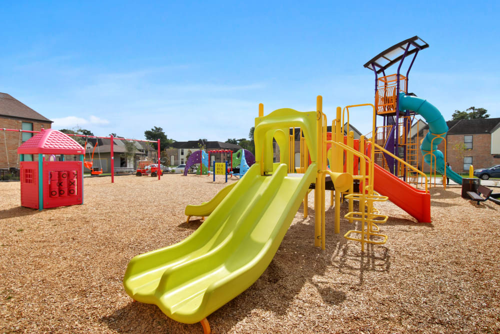 Playground slide and play area at The Mayfair Apartment Homes in New Orleans, Louisiana