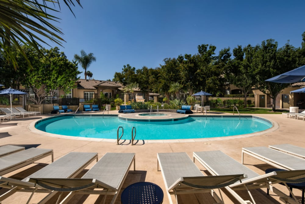 Poolside lounge seating at Castlerock at Sycamore Highlands in Riverside, California