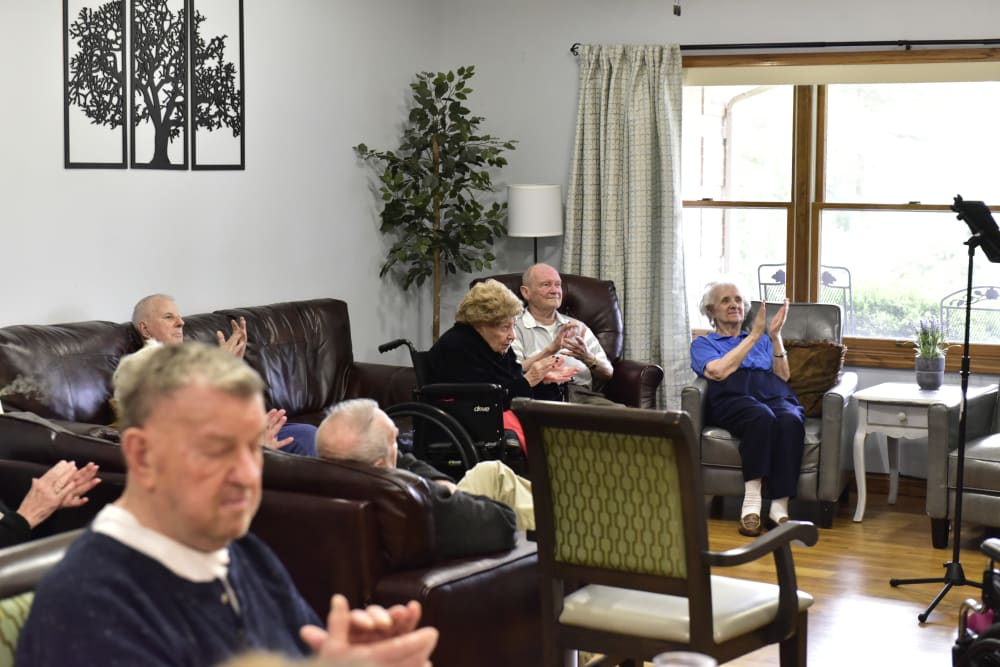 Residents clapping for a music performance at Reflections at Garden Place in Columbia, Illinois.