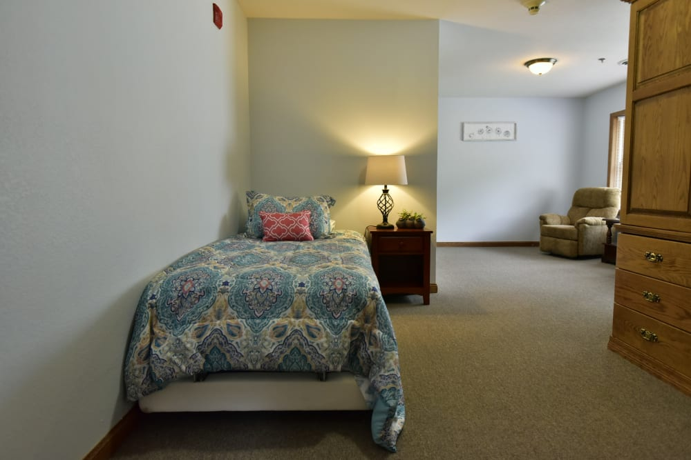 Model resident bedroom at Reflections at Garden Place in Columbia, Illinois.