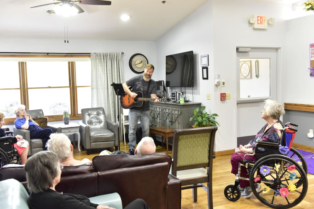 A man performing for the residents at Reflections at Garden Place in Columbia, Illinois.