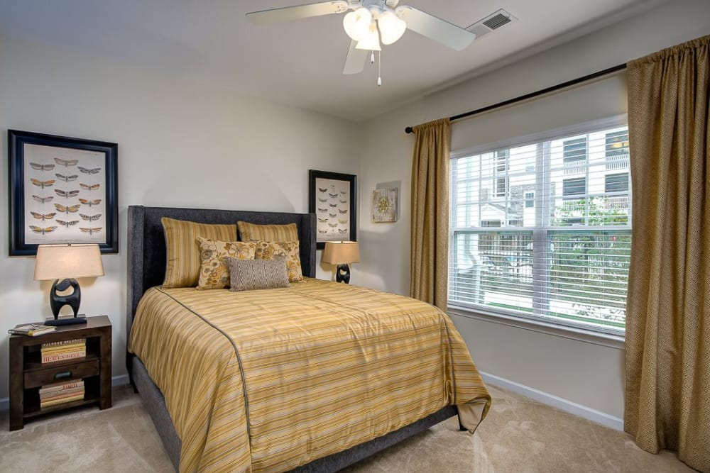 Master bedroom at Oasis at Montclair Apartments in Dumfries, Virginia