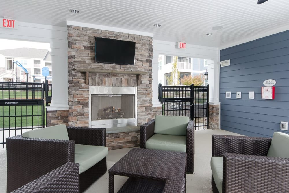 Outdoor lounge with a TV at Oasis at Montclair Apartments in Dumfries, Virginia