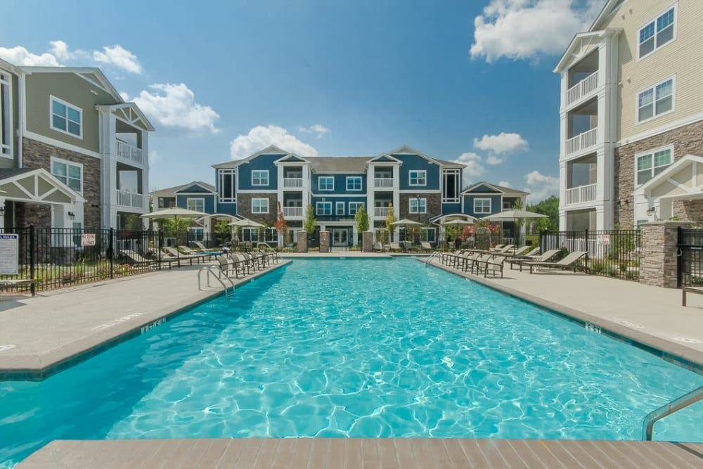 Resort style swimming pool at Oasis at Montclair Apartments in Dumfries, Virginia