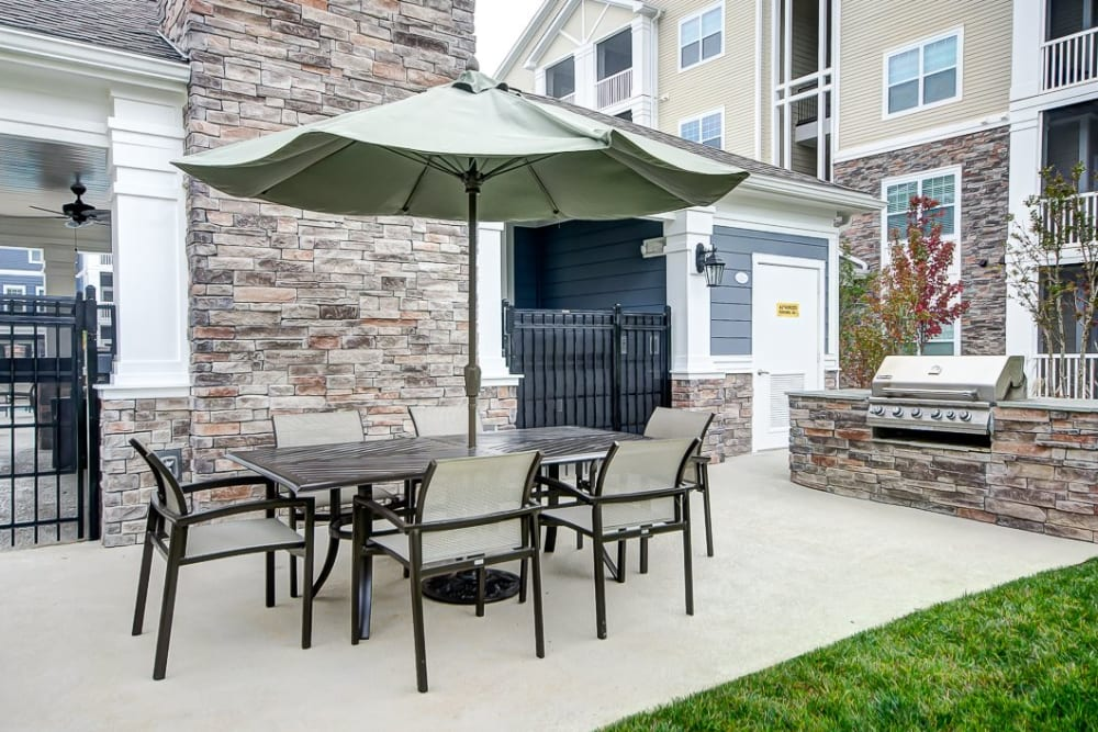 Outdoor patio area at Oasis at Montclair Apartments in Dumfries, Virginia
