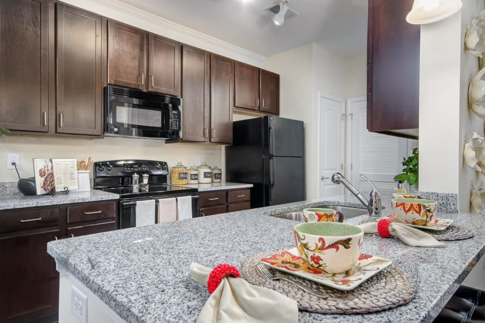 Fully equipped kitchen at Oasis at Montclair Apartments in Dumfries, Virginia