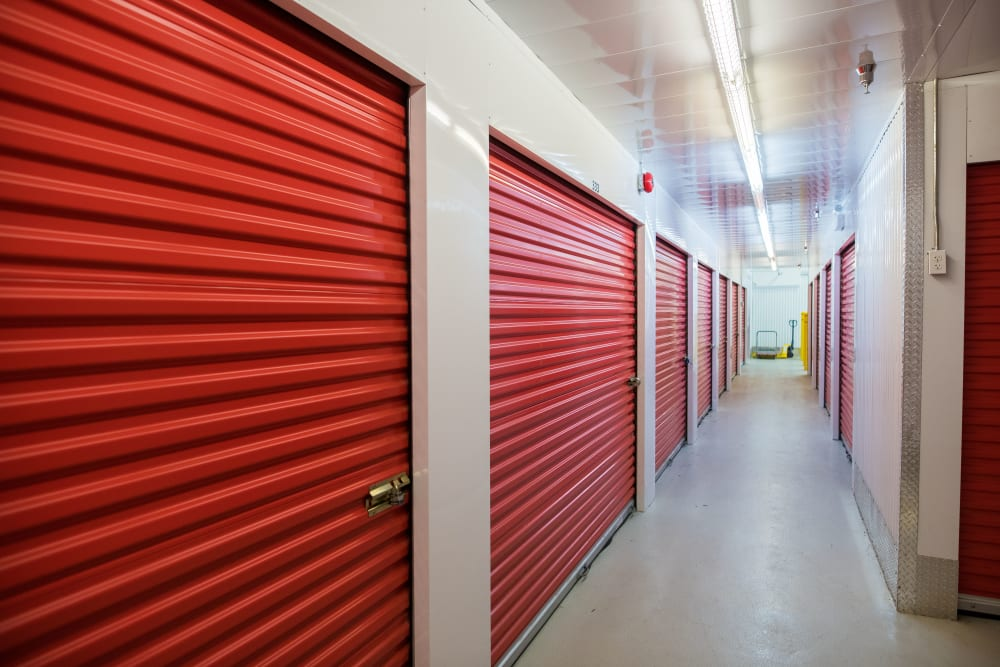 Red doors on interior units at Apple Self Storage - Saint John North in Saint John, New Brunswick