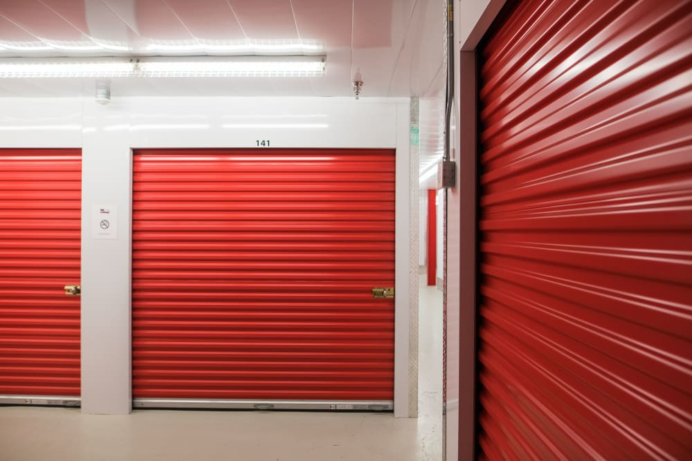 Red doors on units at Apple Self Storage - Saint John North in Saint John, New Brunswick