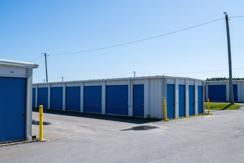 Blue doors on exterior storage units at Apple Self Storage - Saint John West in Saint John, New Brunswick