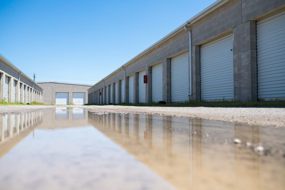 The reflection of storage unit doors in water at Apple Self Storage - St. Catharines in St. Catharines, Ontario
