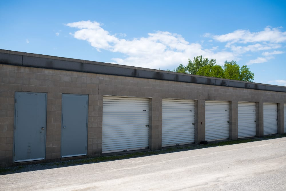 White and blue doors on exterior storage units at Apple Self Storage - St. Catharines in St. Catharines, Ontario
