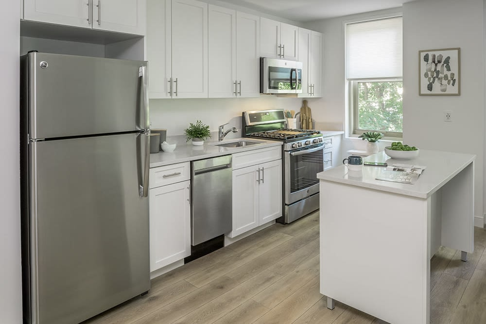 Kitchen with modern appliances at Camelot Court in Brighton, Massachusetts
