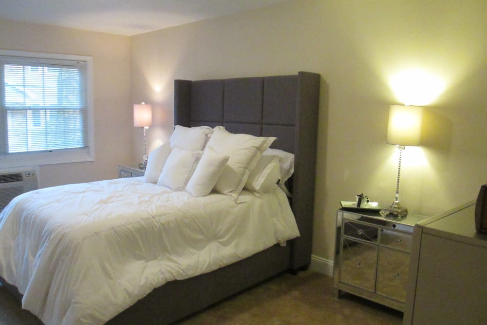 Master bedroom at Eagle Rock Apartments at Woodbury in Woodbury, New York