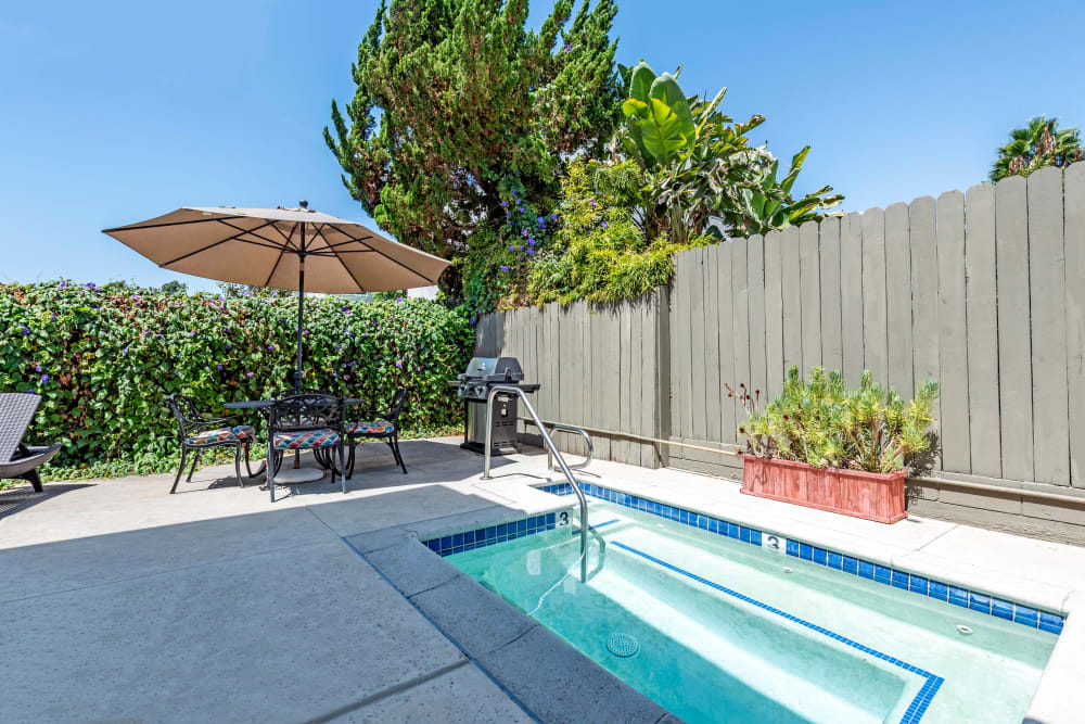 Outdoor pool with seating at Vista Pointe I in Studio City, California