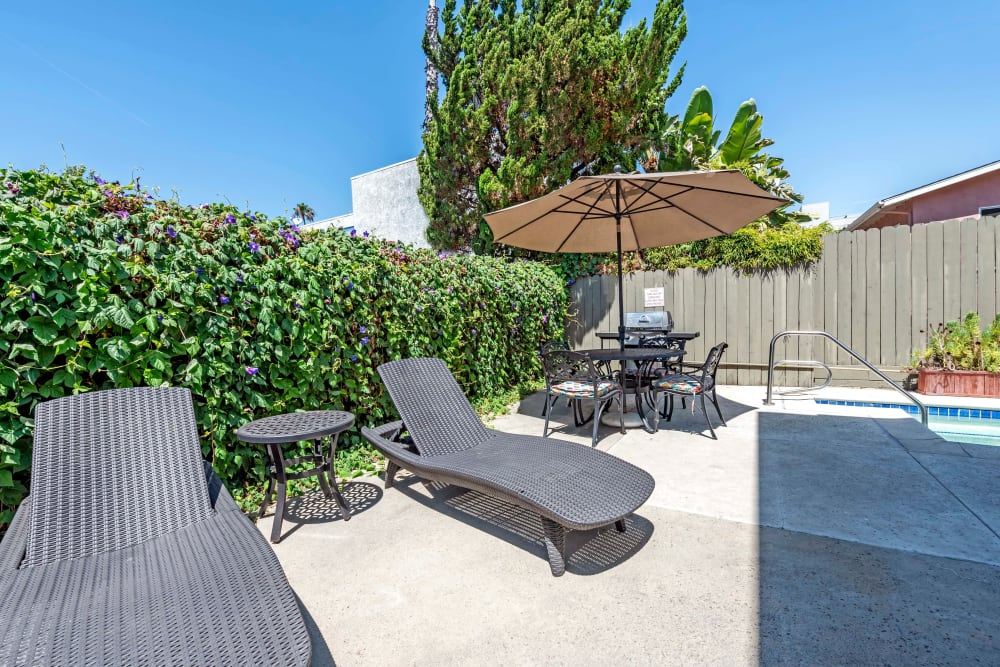 Outdoor pool with sun chairs at Vista Pointe I in Studio City, California