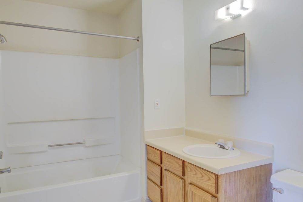 An apartment bathroom at Chateau Apartments of Bossier in Bossier City, Louisiana
