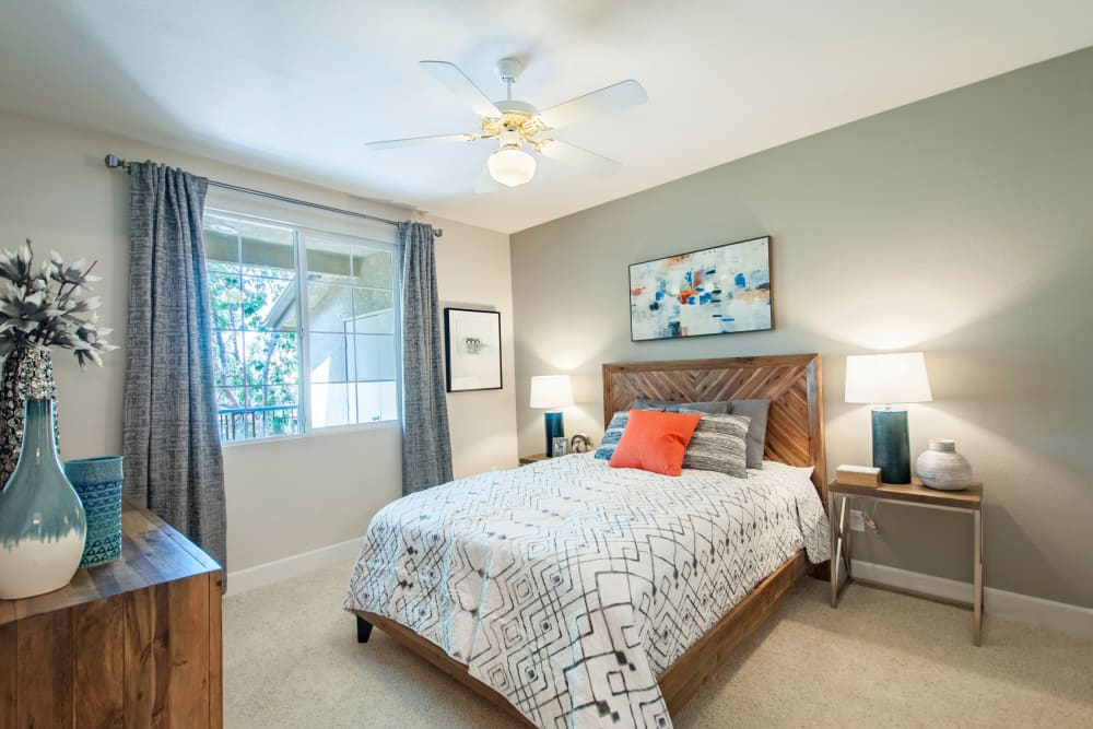 Plush carpeting and a ceiling fan in a model home's bedroom at Sofi Westview in San Diego, California