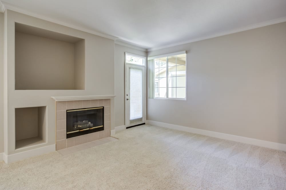 Plush carpeting and a fireplace in a model home's living area at Sofi Westview in San Diego, California