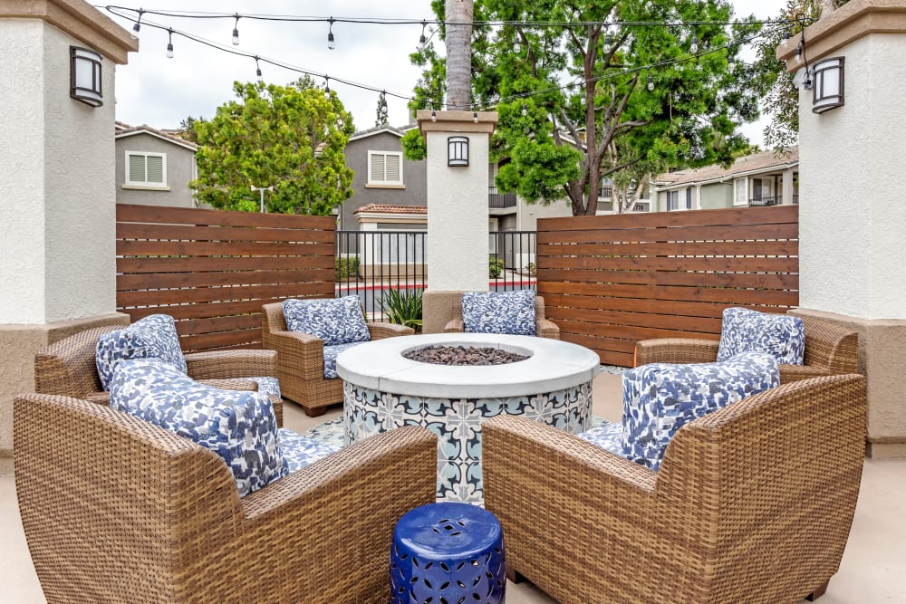 Comfortable wicker chairs around the fire pit at Sofi Westview in San Diego, California