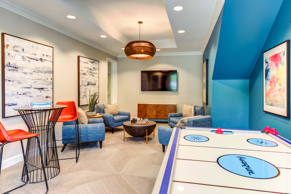 Game room with a flatscreen TV in the resident clubhouse at Sofi Westview in San Diego, California